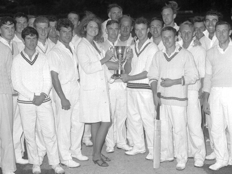 Flashback! Abbotskerswell captain Robin Pugh receives the old Narracott Cup from Roxanne Narracott after his side defeated Barton in the 1966 final. Members of both teams are in the photo