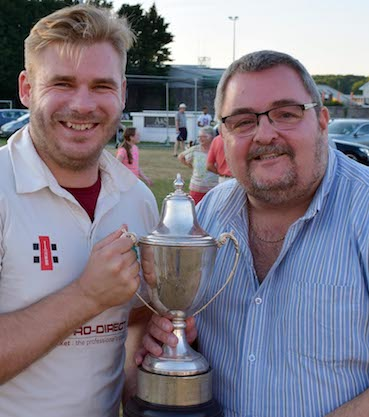 Winning captain Stuart Bowker receives the cup from sponsor Marcel Massey of Aaron Printers