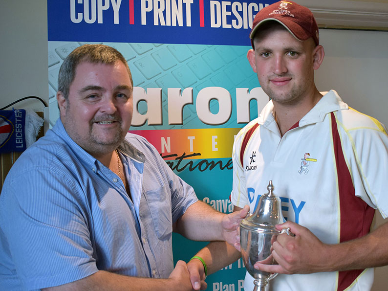 Sponsor Marcel Massey hands the Aaron Printers Cup to winning captain Sam Wakeham<br>credit: Conrad Sutcliffe