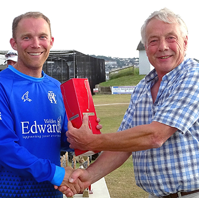 Man of the match Rob Holman collecting his award from Nick Rogers, the DCL chairman