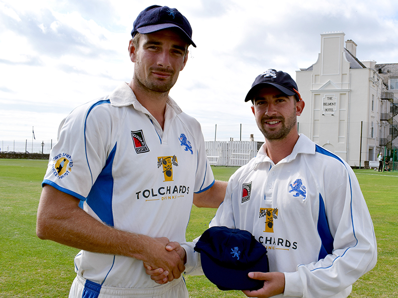Well played - Devon skipper Josh Bess (left) presents Alex Barrow with his cap at the start of day of the game against Dorset at Sidmouth