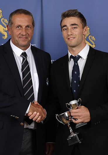 Keith Donohue (left) presenting Zak Bess with the Devon player of the year award in 2016