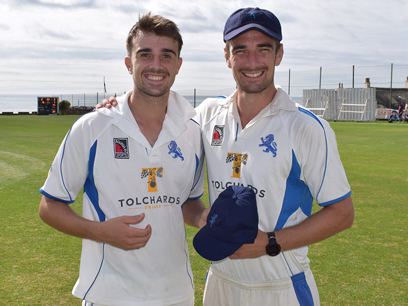 Ben Green (left) receiving his county cap from Devon skipper Josh Bess before the game against Dorset at Sidmouth earlier this week