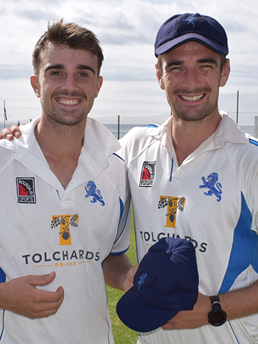 Ben Green (left), who received his county cap from skipper Josh Bess before the first day of the match against Dorset